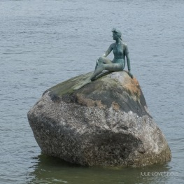 Like The Little Mermaid in Copenhagen, but this is a girl in a wetsuit!